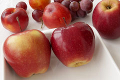 Fruit.Red apple and grapes Stock Photography