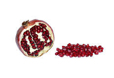 Fruit and red pomegranate grains isolated Royalty Free Stock Photography