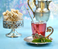 Fruit red tea with sugar and mint Royalty Free Stock Photos