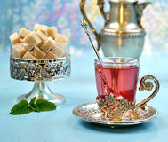 Fruit red tea with sugar and mint Stock Image