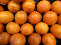 fruit ripe large persimmon whole a close up a background in the market healthy royalty free illustration
