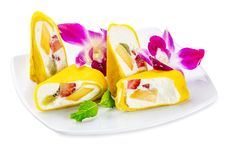 Fruit Roll With Mango And Kiwi plate isolated on white Stock Photo