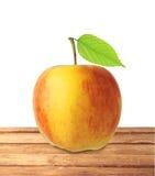 Fruit rouge et jaune de pomme avec la feuille verte sur l'isola en bois de table Photographie stock