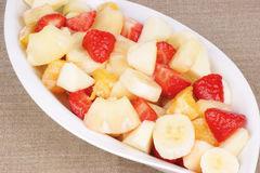 Fruit salad. Fresh fruit salad served on a white plate. Studio shot Royalty Free Stock Photography