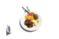 Fruit Salad. A Salad of fresh fruits served in a white plate Stock Photo