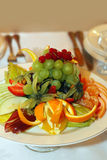 Fruit salad. Salad from fruit and berries close up on a plate royalty free stock photo