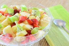 Fruit salad. Fresh fruit salad in a glass cup Royalty Free Stock Photo