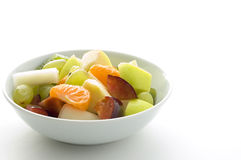 Fruit salad 2. A close up of a fresh fruit salad. Contains grapes, orange, plum, melon, kiwi and apple royalty free stock photography