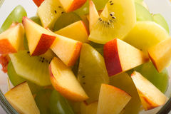 Fruit salad. From kiwi, peach and grapes Stock Images
