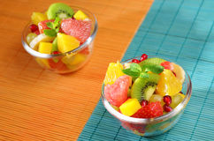 Fruit salad. Healthy fruit salad in the glass bowl Royalty Free Stock Images