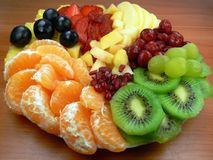 Fruit salad. Orange, kiwi fruit, mango, grapes, cherries, strawberries, pomegranate, pineapple Stock Photo