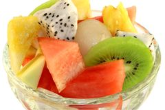 Fruit salad. Fresh tropical fruit salad in a glass serving dish Stock Photos