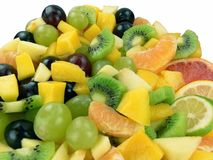 Fruit salad. Orange, grapes, mango, apple, kowi fruit, grapefruit, lemon and lime Stock Photos