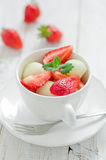 Fruit salad. In a tea cup Stock Images