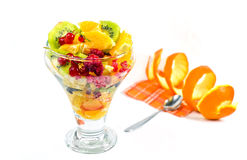 Fruit salad. With kiwi, oranges, raspberries and currants on a white background stock images