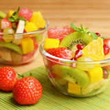 Fruit salad. Healthy fruit salad in the glass bowls Royalty Free Stock Image