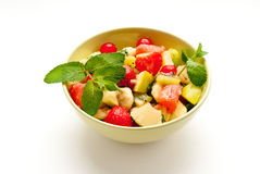 Fruit salad. Fresh fruit salad with green leaves in a bowl Royalty Free Stock Image