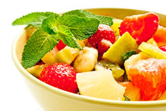 Fruit salad. Fresh fruit salad with green leaves in a bowl Royalty Free Stock Photos