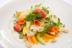Fruit salad. Delicious fruit salad with cheese and herbs Stock Images