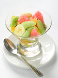 Fruit salad. Fresh fruit salad in glass bowl, selective fcous royalty free stock images