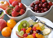 Fruit Salad. Mixed fruit and berries in white dishes Royalty Free Stock Image