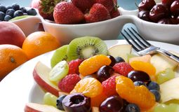 Fruit Salad. Mixed fruit and berries in white dishes Royalty Free Stock Images