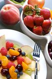 Fruit Salad. Mixed fruit and berries in white dishes Stock Image