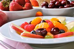Fruit Salad. Mixed fruit and berries in white dishes Stock Photos