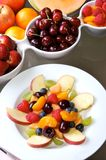 Fruit Salad. Mixed fruit and berries in white dishes Royalty Free Stock Photo