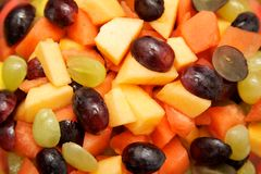 Fruit Salad. A colorful mix of grapes, watermelon, and cantaloupe come together in this fruit salad Stock Image
