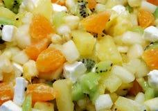 Fruit Salad. Tasty Fruit Salad  Made of Orange, Apple, Pears, Kiwi, Banana, Marshmallow Ingridients Closeup. Can be used as Background Stock Photo