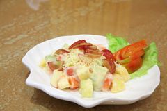 Fruit salad. On white plate closeup Royalty Free Stock Images