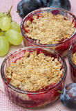 Fruit salad. With cereals on top glass bowl Royalty Free Stock Images