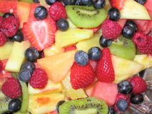 Fruit Salad. A fruit salad containing Oregon Strawberries, blue berries, kiwi fruit, pineapple, and raspberries stock image