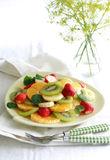 Fruit Salad. On a pale green plate with two dessert forks Stock Photography