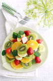 Fruit salad. A plate of fruit salad in aerial view Stock Image
