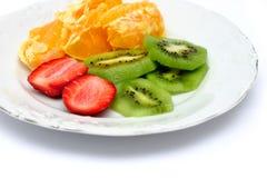 Fruit Salad. Colorful fruit salad on white background stock photography