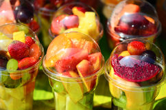 Fruit Salad arranged in plastic cups Royalty Free Stock Photos