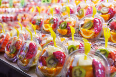 Fruit Salad arranged in plastic cups on a market Royalty Free Stock Photo