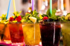 Fruit Salad arranged in plastic cups on a market stall focus on middle front cup. Stock Images