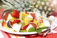 Fruit salad on the background of fresh pineapple Stock Image
