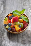Fruit salad in a bamboo bowl, vertical Royalty Free Stock Images