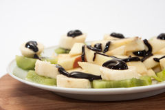 Fruit salad with banana and kiwi topped with chocolate cream Stock Photography