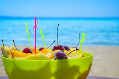 Fruit salad on the beach Stock Photo