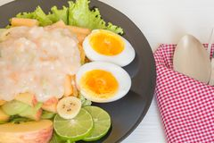 Fruit salad and boiled eggs royalty free stock photos