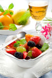 Fruit salad on bowl. On restaurant table Royalty Free Stock Photography