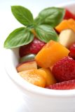 Fruit Salad Bowl. A white bowl of freshly chopped fruit salad stock photos