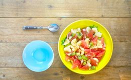 Fruit salad in bowl, flat lay, vitamin Royalty Free Stock Images