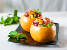 Fruit salad in a bowl of grapefruit Stock Photography