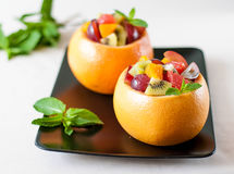 Fruit salad in a bowl of grapefruit Royalty Free Stock Photography